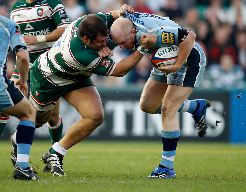 Photo: Richard Lane/Richard Lane Photography..Leicester Tigers v Cardiff Blues. EDF Energy Cup. 03/11/2007. .Blues' Tom Shanklin (rt) is tackled by Tigers' Martin Castrogiovanni.