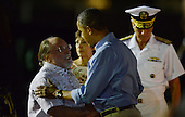 United States President Barack Obama greets State of Hawaii Governor Neil Abercrombie as he arrives at Joint Base Pearl Harbor-Hickam in Honolulu, Hawaii for their winter vacation on December 20, 2013.<br /> Credit: Cory Lum / Pool via CNP