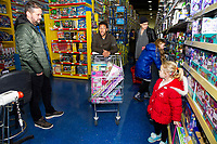 Pictured: Wayne Routledge of Swansea City buying children gifts at Smyth's Toy Store, in Swansea, Wales, UK. Wednesday 19 December 2018