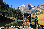 Photographers, one using a view camera, Maroon Lake and Maroon Bells Peaks, west of Aspen, Colorado, USA John offers autumn photo tours throughout Colorado.