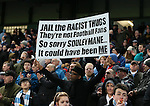 A Manchester City fan holds up a banner in reference to the Chelsea racist incident - Barclays Premier League - Manchester City vs Newcastle Utd - Etihad Stadium - Manchester - England - 21st February 2015 - Picture Simon Bellis/Sportimage