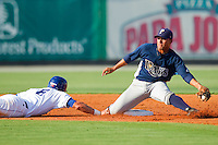 Shortstop Felix Gonzalez #7 of the Princeton Rays reaches back for a throw as Gabe MacDougall #6 of the Burlington Royals dives head first into second base at Burlington Athletic Stadium July 11, 2010, in Burlington, North Carolina.  Photo by Brian Westerholt / Four Seam Images
