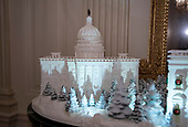"The 2018 White House Christmas decorations, with the theme ""American Treasures"" which were personally selected by first lady Melania Trump, are previewed for the press in Washington, DC on Monday, November 26, 2018.  The traditional White House gingerbread house on display in the State Dining Room.  This year it shows the National Mall with the White House as it's centerpiece. The gingerbread US Capitol is shown in this photo. <br /> Credit: Ron Sachs / CNP"