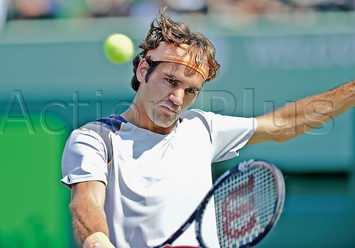 31.03.2011 Roger Federer plays against Gilles Simon in the quarterfinals of the Sony Ericsson Open at the Tennis Center at Crandon Park Key Biscayne Florida.  Federer won the match 3-0 when Simon retired with a neck injury.