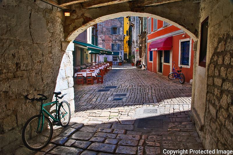 Outdoor cafe in narrow cobblestone street/alley, Rovigno, Croatia