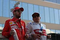 1st December 2019; Yas Marina Circuit, Abu Dhabi, United Arab Emirates; Formula 1 Abu Dhabi Grand Prix, race day; Scuderia Ferrari, Sebastian Vettel and Alfa Romeo Racing, Kimi Raikkonen - Editorial Use