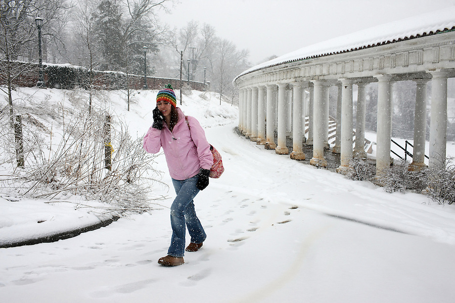 A student walks through snow Lambeth Field at the University of Virgnia,