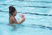 NWA Democrat-Gazette/J.T. WAMPLER Darcy Estrada of Springdale holds her dog Gaga Sunday Sept 10, 2017 during Wags and Waves  at the Springdale Aquatic Center which is closed for the season. The event was for people to bring their dogs and play in the pool with money and product donations going to the Springdale Animal Services. For more images from the event go to nwamedia.photoshelter.com/