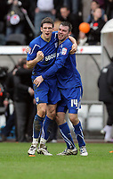 ATTENTION SPORTS PICTURE DESK<br /> Pictured: Cardiff players L-RMark Hudson and Paul Quinn celebrating their wn after the end of the game<br /> Re: npower Championship Swansea City FC v Cardiff City FC at the Liberty Stadium, south Wales. Sunday 06 February 2011
