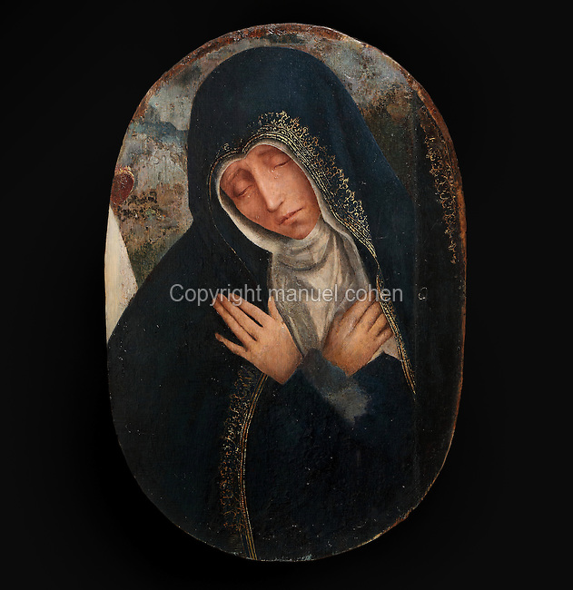 Virgin of Sorrows, from a Triptych of the Virgin of the Calvary, 1514-17, by Quentin Metsys, 1466-1530, originally for the Mosteiro de Santa Clara, in the Museu Nacional de Machado de Castro, Coimbra, Portugal. The triptych was commissioned by King Dom Manuel I, 1469-1521. The museum was opened in 1913 and renovated 2004-2012. The city of Coimbra dates back to Roman times and was the capital of Portugal from 1131 to 1255. Its historic buildings are listed as a UNESCO World Heritage Site. Picture by Manuel Cohen