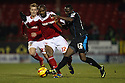 Francois Zoko of Stevenage tackles Dany N'Guessan of Swindon<br />  - Swindon Town v Stevenage - Johnstone's Paint Trophy - Southern Section Semi-final  - County Ground, Swindon - 10th December, 2013<br />  © Kevin Coleman 2013