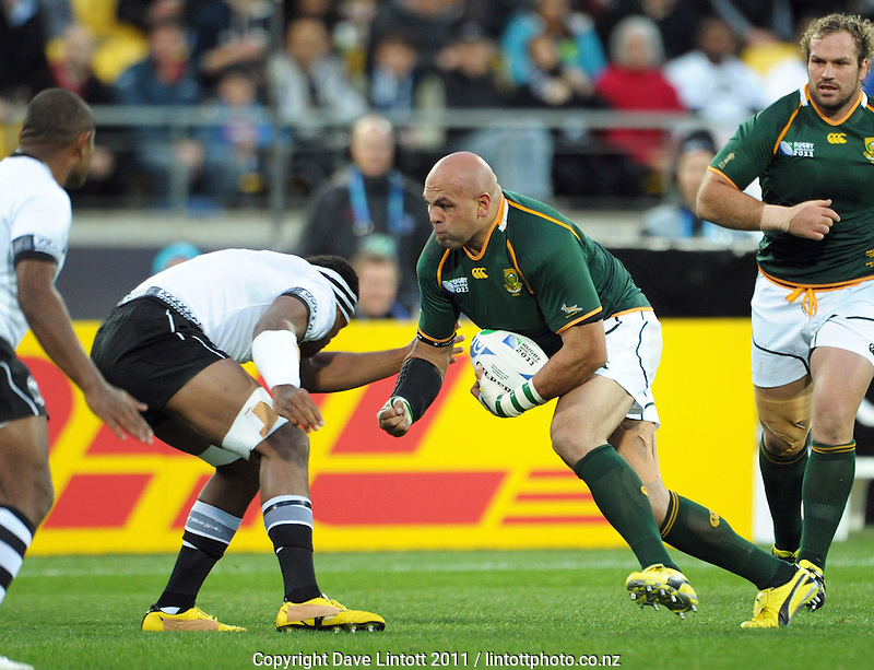 Springbok prop Gurthro Steenkamp takes the ball in contact during the South Africa versus Fiji pool D match of the 2011 IRB Rugby World Cup at Wellington Regional Stadium, Wellington, New Zealand on Saturday, 17 September 2011. Photo: Dave Lintott / lintottphoto.co.nz