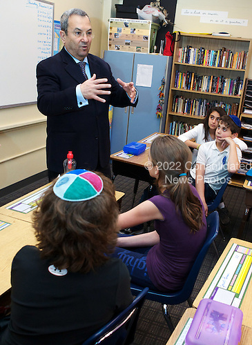Israeli Defense Minister Ehud Barak speaks with students at the Jewish Primary Day School of the Nation's Capital in Washington DC, December 15, 2011. Barak, also a former prime minister, toured the school, spoke in both Hebrew and English with kids in two classrooms and listened as they sang Israeli songs. The visit was part of the school's Yitzhak Rabin memorial series, named for the late prime minister. ..Mandatory Credit: Chris Kleponis - H/O via CNP