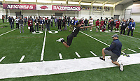 NWA Democrat-Gazette/J.T. WAMPLER  HenrŽ Toliver jumps Monday March 26, 2018 while trying put for scouts at the Walker Pavilion at the University of Arkansas. Former players had a chance to demonstrate their skills ahead of  the NFL Draft and free agency signings.