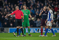 Arsenal's Bernd Leno having words with the referee Anthony Taylor over a disallowed goal while Arsenal's Sead Kolasinac (right) discussed the matter with Brighton & Hove Albion's Glenn Murray <br /> <br /> Photographer David Horton/CameraSport<br /> <br /> The Premier League - Brighton and Hove Albion v Arsenal - Wednesday 26th December 2018 - The Amex Stadium - Brighton<br /> <br /> World Copyright © 2018 CameraSport. All rights reserved. 43 Linden Ave. Countesthorpe. Leicester. England. LE8 5PG - Tel: +44 (0) 116 277 4147 - admin@camerasport.com - www.camerasport.com