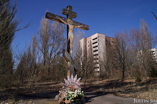 A crucifix at the entrance to Pripyat, a ghost town left deserted by the nuclear disaster in the Chernobyl power station nearby. 30 years on, the city is still heavily contaminated, unfit for human life. <br /> <br /> The Chernobyl nuclear disaster happened on 26 April 1986.