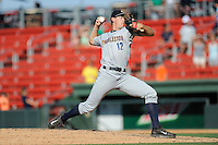 Pitcher Philip Wallby (12) of the Charleston RiverDogs delivers a pitch in a game against the Greenville Drive on Sunday, June 28, 2015, at Fluor Field at the West End in Greenville, South Carolina. Charleston won, 12-9. (Tom Priddy/Four Seam Images)