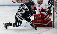 BOSTON, MA - FEBRUARY 16: Kate Stuart #1 of Boston University blocks shot by Taylor Wenczkowski #12 of University of New Hampshire during a game between University of New Hampshire and Boston University at Walter Brown Arena on February 16, 2020 in Boston, Massachusetts.