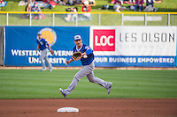 Darwin Barney (12) of the Oklahoma City Dodgers fields a grounder during the game against the Salt Lake Bees in Pacific Coast League action at Smith's Ballpark on May 25, 2015 in Salt Lake City, Utah.  (Stephen Smith/Four Seam Images)