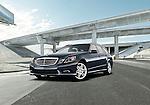 One dark blue 2011 Mercedes-Benz E350 4Matic Wagon outdoors near a freeway overpass.