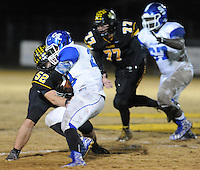 NWA Democrat-Gazette/ANDY SHUPE<br /> Dakota Hutchison (52) of Prairie Grove tackles Jaylen Mallett of Star City Friday, Nov. 27, 2015, during the first half of play at Tiger Stadium in Prairie Grove. Visit nwadg.com/photos to see more photographs from the game.