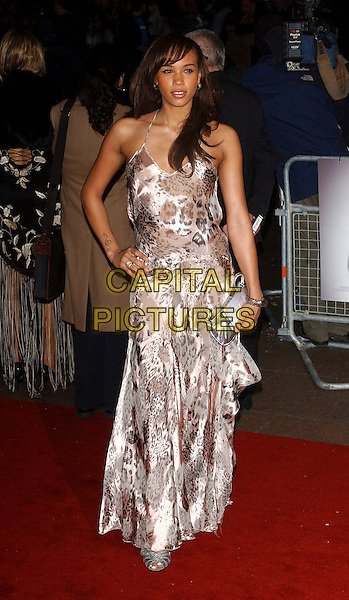 "JAVINE HYLTON.""Get Rich Or Die Tryin'"" UK film premiere at Empire leicester Square. London, UK..January 17th, 2006.Ref: BEL.full length hand on hip pink leopard print silk satin dress silver purse.www.capitalpictures.com.sales@capitalpictures.com.© Capital Pictures."
