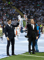 Calcio, finale di Champions League: Real Madrid vs Atletico Madrid. Stadio San Siro, Milano, 28 maggio 2016.<br /> FC Inter and AC Milan past champions Javier Zanetti, left, and Franco Baresi hold the trophy prior to the start of the Champions League final match between Real Madrid and Atletico Madrid, at Milan's San Siro stadium, 28 May 2016.<br /> UPDATE IMAGES PRESS/Isabella Bonotto