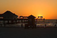 Sunset on the Gulf of Mexico at the Clearwater Beach Florida Pier.