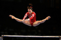 Sept 8, 2007; Stuttgart, Germany;  Beth Tweddle of Great Britain performs release move on uneven bars on way to 4th place in the event final in women's artistic gymnastics at 2007 World Championships. Photo by Tom Theobald. Copyright 2007 by Tom Theobald
