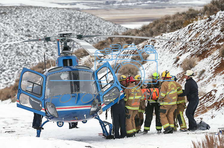 Carson City Fire personnel rescue a 40-year-old man who was injured after his truck rolled 400 feet off Goni Road in Carson City, Nev., on Wednesday, Jan. 6, 2016. The man spent about a day in the wreckage until family members located him and called authorities. He was taken to a Reno hospital for treatment. <br /> Photo by Cathleen Allison/Nevada Photo Source