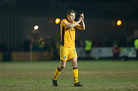 Sid Nelson of Newport County claps the fans at full time of the Sky Bet League 2 match between Newport County and Doncaster Rovers at Rodney Parade, Newport, Wales on 10 February 2017. Photo by Mark  Hawkins / PRiME Media Images.