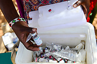 KENYA, Marsabit, Samburu village Hargura, mobile health unit for mothers and infants, Tetanus Toxoid vaccine, made in India, in cooling box / KENIA, Marsabit, Samburu Dorf Hargura, mobile Gesundheitsstation fuer Muetter und Kleinkinder, Tetanus Impfstoff in Kuehlbox