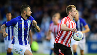 Lincoln City trialist shields the ball from Sheffield Wednesday's Daniel Pudil<br /> <br /> Photographer Chris Vaughan/CameraSport<br /> <br /> Football Pre-Season Friendly - Lincoln City v Sheffield Wednesday - Friday 13th July 2018 - Sincil Bank - Lincoln<br /> <br /> World Copyright &copy; 2018 CameraSport. All rights reserved. 43 Linden Ave. Countesthorpe. Leicester. England. LE8 5PG - Tel: +44 (0) 116 277 4147 - admin@camerasport.com - www.camerasport.com