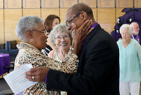 NWA Democrat-Gazette/DAVID GOTTSCHALK Peggy Taylor Lewis (left) is greeted by John L. Colbert, superintendent Fayetteville Public Schools, Thursday, August 2, 2018, during the 2018 Hall of Honor Luncheon hosted by the Fayetteville Public Education Foundation at Fayetteville High School. The 2018 inductees are Dr. James Hunt, George Spencer, Mary Faye Jones and Lewis.