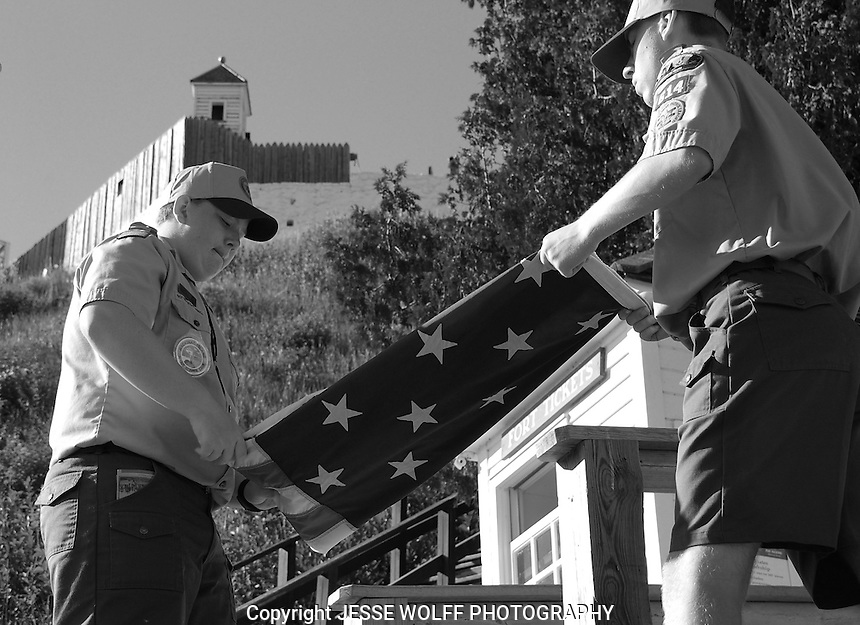 I thought this was a cool shot of boy scouts folding the american flag on Mackinac Island, MI as the sun went down.