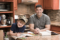 Andrew and Hudson read together in the kitchen