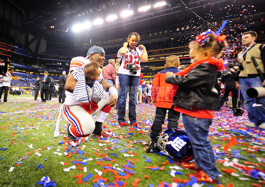 Feb 5, 2012; Indianapolis, IN, USA; New York Giants defensive back Derrick Martin (22) celebrates with family after the Giants defeated the New England Patriots 21-17 in Super Bowl XLVI at Lucas Oil Stadium.  Mandatory Credit: Mark J. Rebilas-.