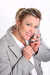 A business woman talking on a cordless phone