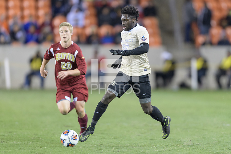 Houston, TX - Friday December 9, 2016: Ema Twumasi (22) of the Wake Forest Demon Deacons races with the ball towards the goal against the Denver Pioneers at the NCAA Men's Soccer Semifinals at BBVA Compass Stadium in Houston Texas.