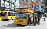 BNPS.co.uk (01202 558833)<br /> Pic:   RogerArbon/BNPS <br /> <br /> Passengers boarding the bus in Gervis Place, Bournemouth.<br /> <br /> A small group of volunteers have reintroduced a historic seaside bus service after spending five years restoring the original bus that travelled the route 50 years ago.<br /> <br /> The classic yellow open top 1965 Daimler Fleetline double decker is back running the old 'Route 12'  service between Bournemouth and Hengistbury Head.<br /> <br /> The volunteers drive and conduct the bus, as well as maintaining it and producing the timetables and bus stop flags.<br /> <br /> The vintage Bournemouth Corporation Transport bus ran along the idyllic five mile stretch of Dorset coastline from 1965 to 1977.<br /> <br /> But it had fallen into a 'sorry state' and was languishing in a depot when it was purchased by the volunteers from a bus operator in Purfleet, Essex, for £2,000 in 2014.