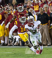 LOS ANGELES, CA - November 16, 2013:  Stanford Cardinal wide receiver Ty Montgomery (7) tries to catch a ball that is just out of reach during the Stanford Cardinal vs the USC Trojans at Los Angeles Memorial Coliseum in Los Angeles, CA. Final score Stanford Cardinal 17, USC Trojans  20.