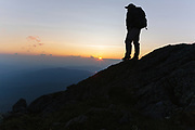 Silhouette of a hiker on the Appalachian Trail at sunset, near Mount Clay, in the White Mountains of New Hampshire.