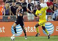 Dejan Jakovic #5 of D.C. United races away from Andy Iro #6 of the Columbus Crew during a US Open Cup semi final match at RFK Stadium on September 1 2010, in Washington DC. Columbus won 2-1 aet.