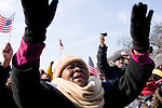 Spectators cheer and wave American flags as Barack Obama is sworn in as the 44th president of the United States of America, Tuesday, Jan. 20, 2009, in Washington, D.C. (Heather Halstead/pressphotointl.com)