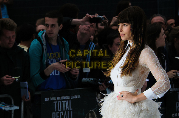 Jessica Biel (wearing Giambattista Valli).'Total Recall' UK Film Premiere arrivals, Vue Leicester Square, London, England..August 16th, 2012.half length long-sleeved dress feathered waist beads beaded hand on hip sheer profile lace high collar holes ripped torn armpit .CAP/CJ.©Chris Joseph/Capital Pictures.