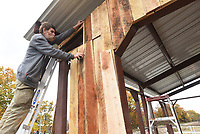 NWA Democrat-Gazette/FLIP PUTTHOFF <br />AVOCA PAVILION<br />Tom O'Dell, Avoca interim mayor, installs Tuesday Nov. 6 2018 rough-sawn white oak boards on a pavilion being built at U.S. 62 and Rose Street in Avoca. The pavilion should be finished in 10 days to two weeks and available for public use on a first-come, first-served basis, O'Dell said. It has lighting and electricity. A railroad depot was once at the pavilion site, O'Dell added.