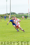 An Ghaeltacht Cian Ó Murchú in possession of the ball closely watched by Spa Cormac Cronin during the County League Div. 2 round 11 match at Gallarus on Sunday afternoon.
