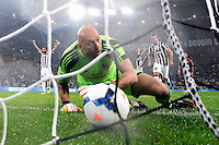 AC Milan's goalkeeper Christian Abbiati fails to save a free kick shot by Juventus' Andrea Pirlo during their Italian Serie A match at Juventus Stadium in Turin October 6, 2013.