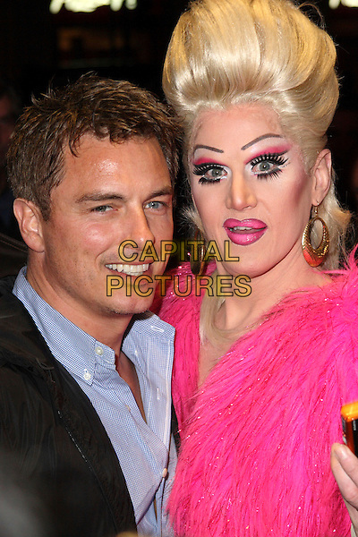 "JOHN BARROWMAN & GUEST.""Priscilla Queen of the Desert"" Opening Gala Night at the Palace Theatre, London, England.  .March 24th, 2009.headshot portrait black jacket blue shirt pink drag queen wig make-up.CAP/JIL.©Jill Mayhew/Capital Pictures"