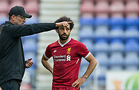 Liverpool Manager Jurgen Klopp gives instructions to Mohamed Salah of Liverpool during the pre season friendly match between Wigan Athletic and Liverpool at the DW Stadium, Wigan, England on 14 July 2017. Photo by Andy Rowland.